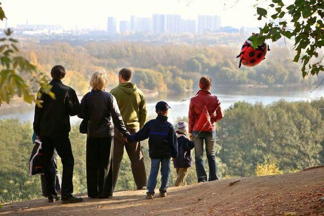silhouette of family admiring an autumn decline